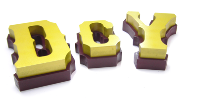 closeup of spray painted mdf letters