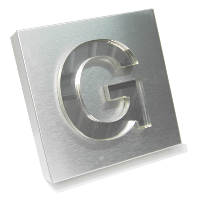 plastic chrome letters mounted on a brushed  steel sign panel